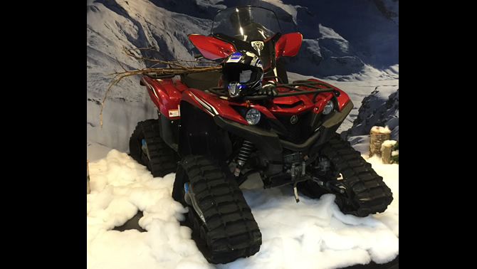 A Grizzly ATV tricked up with a Camoplast 4TS track conversion kit.