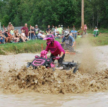 Anne Kotula of Grand Rapis Minnesota riding her ATV through a mud bog.