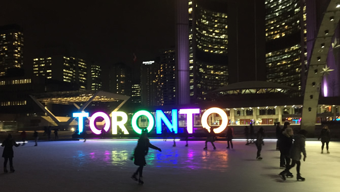 Skaters at the outdoor rink in front of Toronto City Hall.