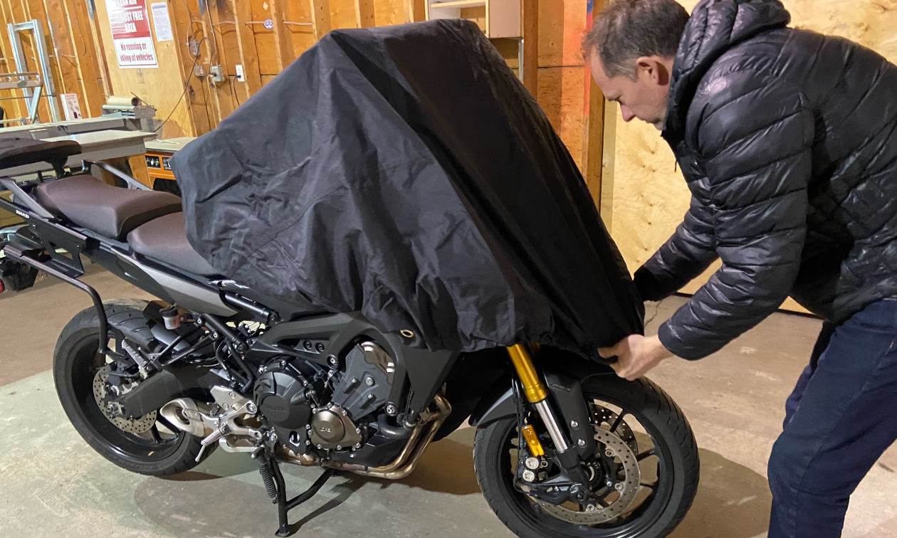 Phil Budiselich instals the Badass Moto Ultimate All Wx Waterproof Motorcycle Cover onto his 2015 Yamaha FJ-09 motorcycle.