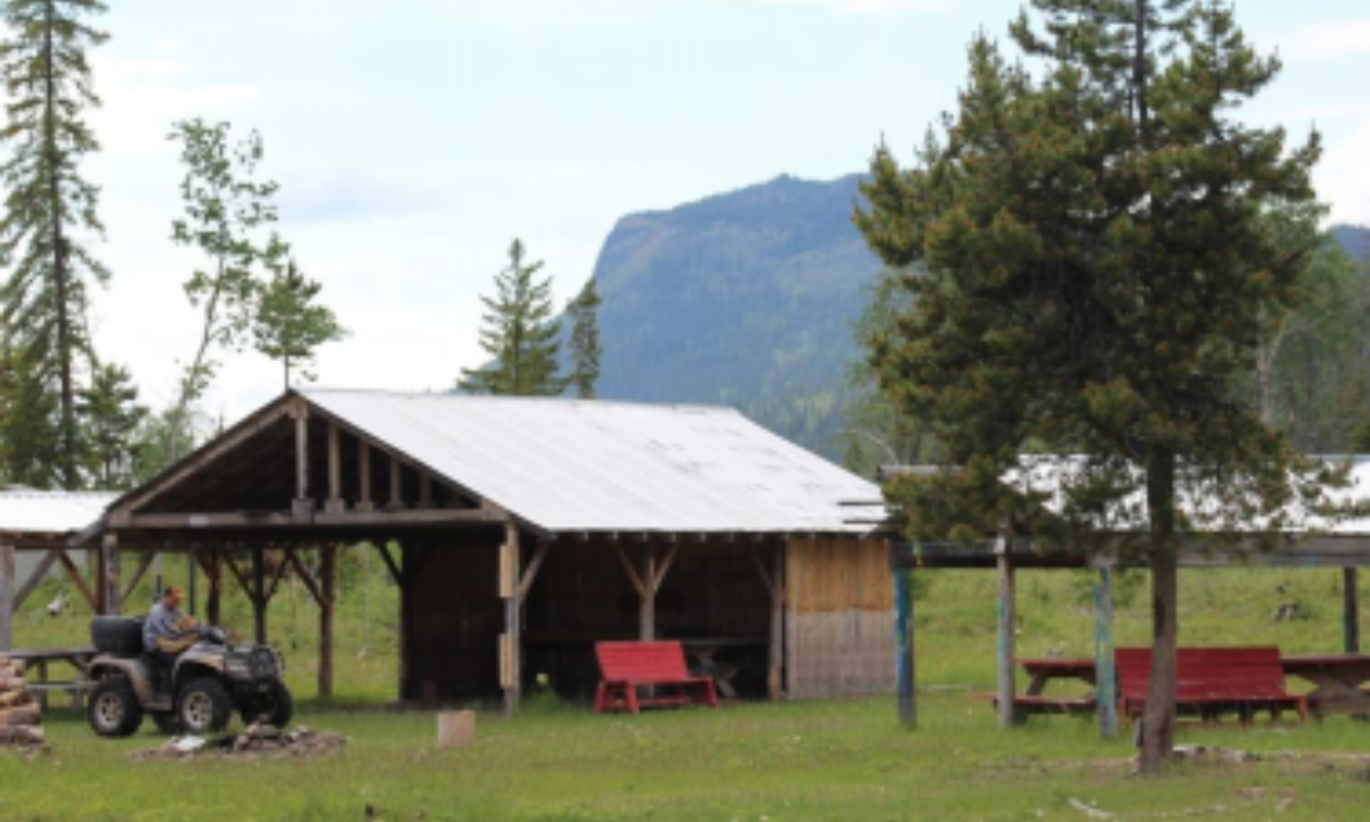The Cheslatta Carrier Nation Community Grounds at the end of the Sather FSR with  Tyee Butte in the background.