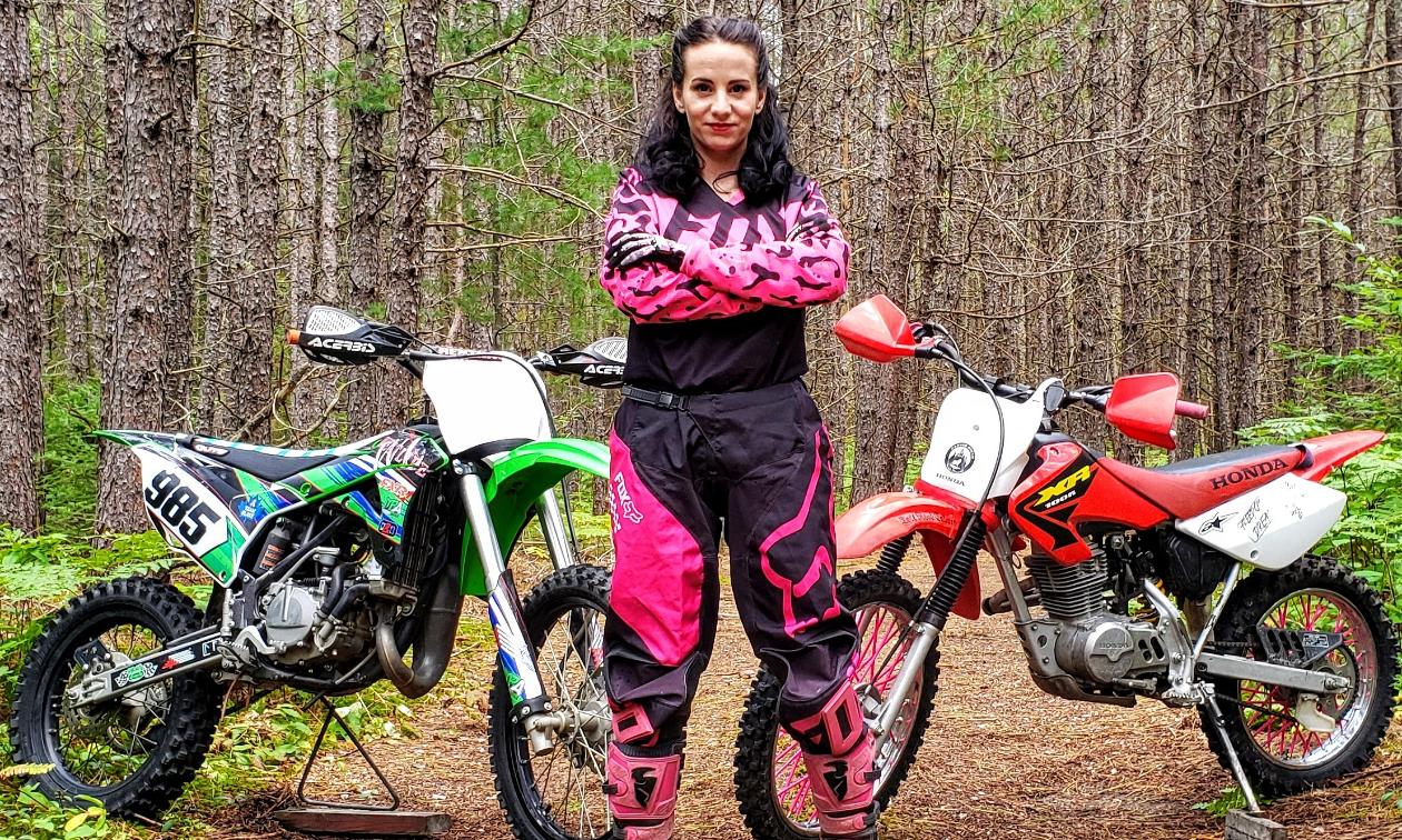 Jessica Rainville poses with her 2018 Kawasaki KX100 and 2003 Honda XR100 dirt bikes.