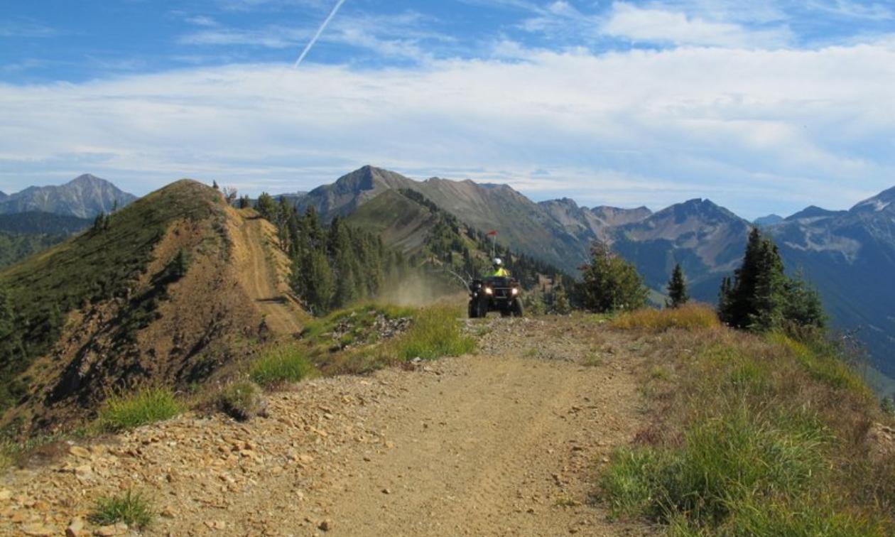 An ATVer ascends a mountain.