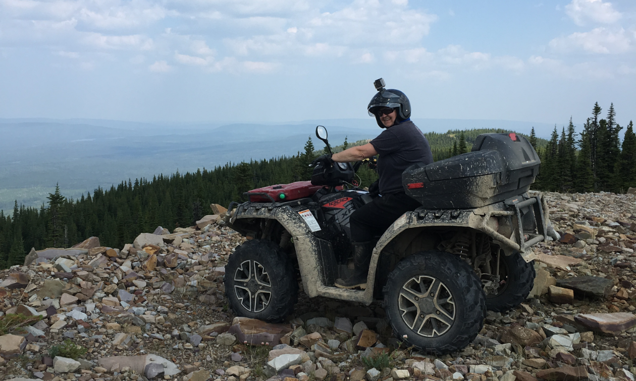 Nycole Ross rides a Polaris Sportsman 1000 quad on top of Tabor Mountain.