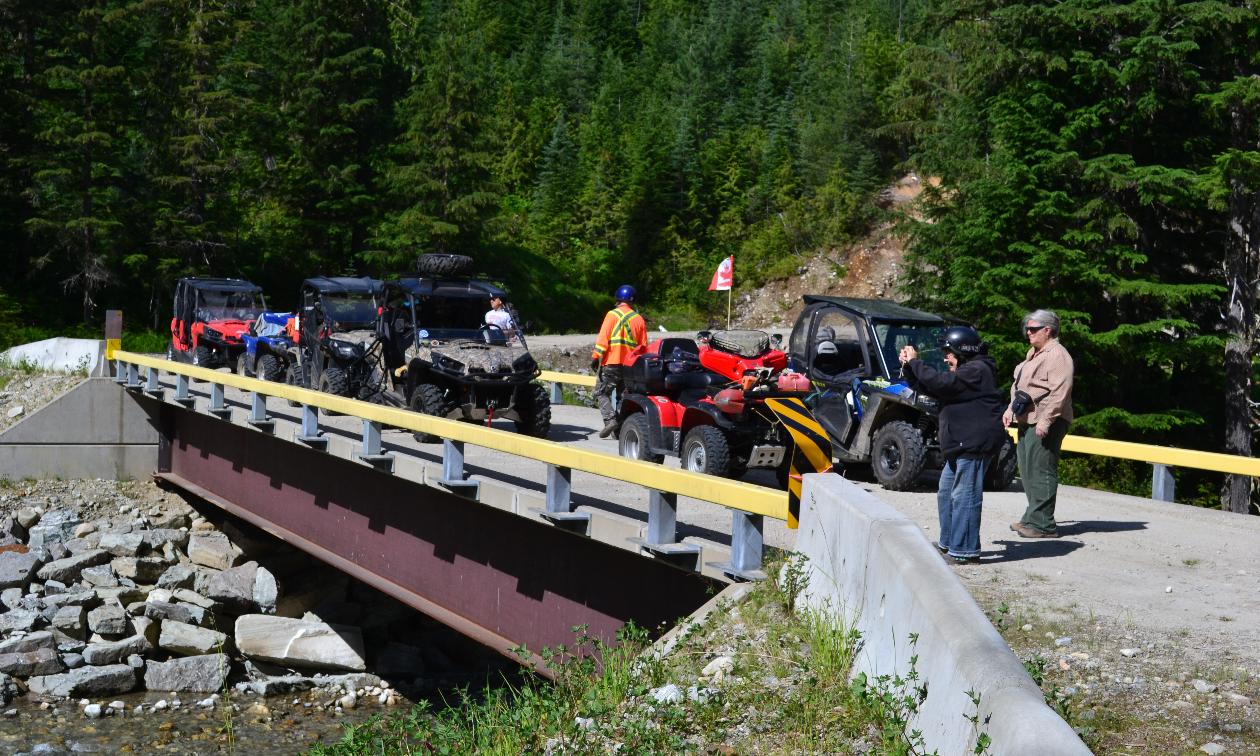 ATVers gather and take a break on a bridge.