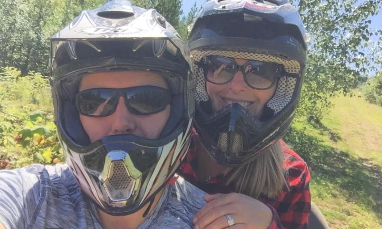 Sean Ellis and Melanie Berry wear sunglasses and ATV helmets.