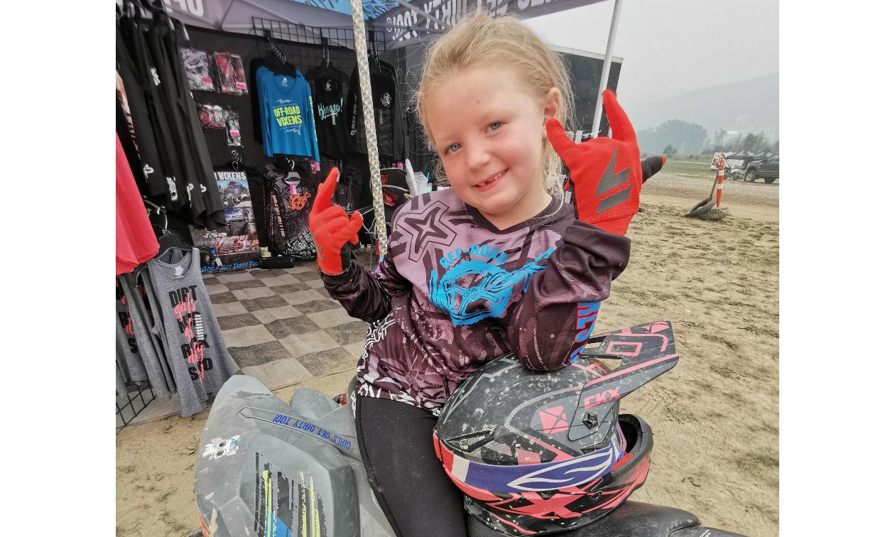 Lilly Van Leeuwen throws up the devil horns on her ATV.