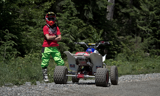 Christian Gagnon stands beside his ATV.
