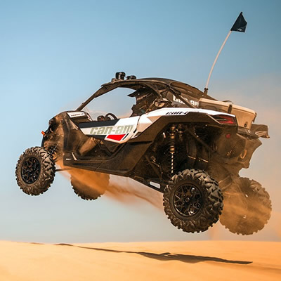 2018 Can-Am Maverick X3 R soaring over the dunes.