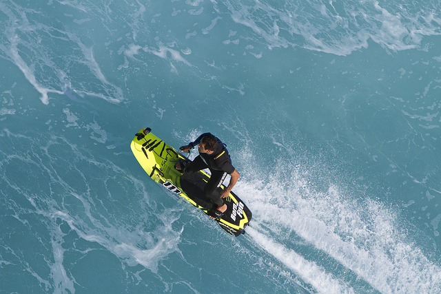An overhead view of a man riding a JetSurf board