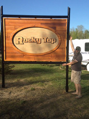 Kevin Butler in front of the new Rocky Top ATV Park Entrance sign