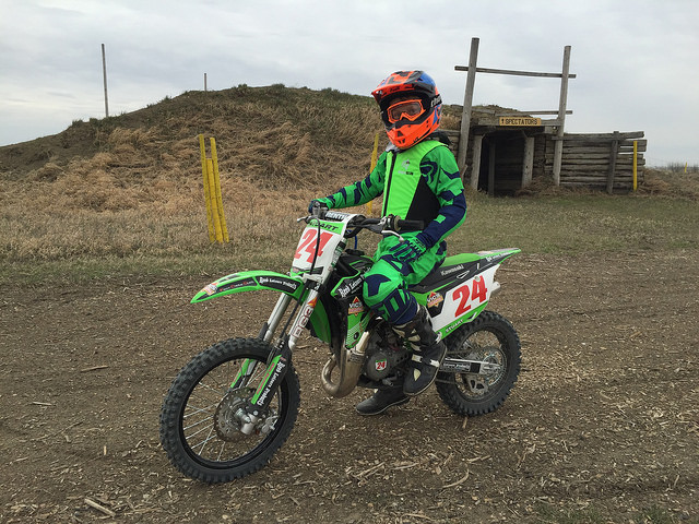 Logan Stuart on No 24 green bike and matching green outfit.