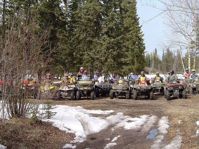 A group of friends ATVing in the Cold Lake area.