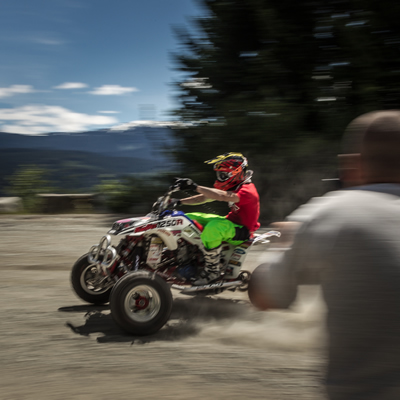 Christian Gagnon flies past the camera on his ATV.