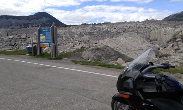 Motorcycle parked along Crowsnest Highway 3 at Frank Slide.