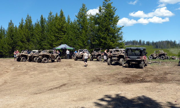 A group of Side-by-Sides at at poker run stop.