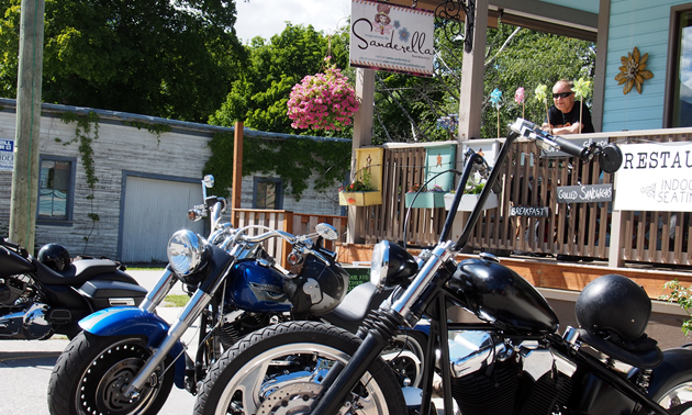 Motorcycles parked in front of Sanderella souvenir shop.