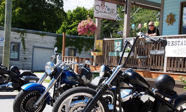 Motorcycles parked in front of Sanderella souvenir shop.