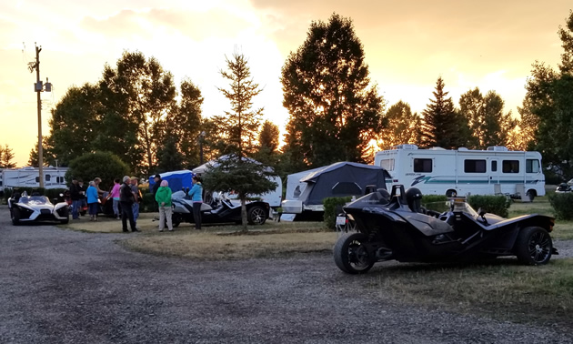 A Slingshot is parked in a campground.