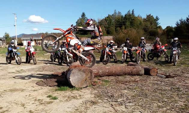 Chris Birch clears a log on his bike.