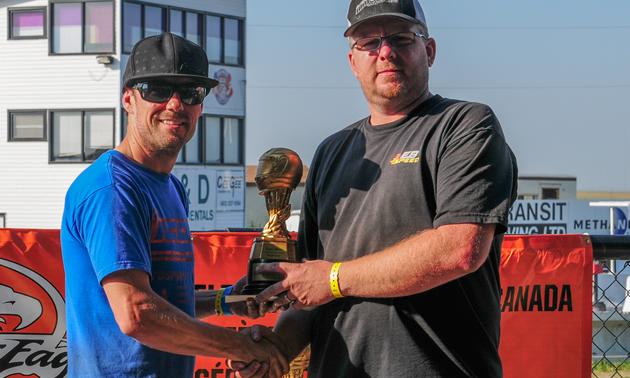 Chris Klassen accepts the Super Street trophy.