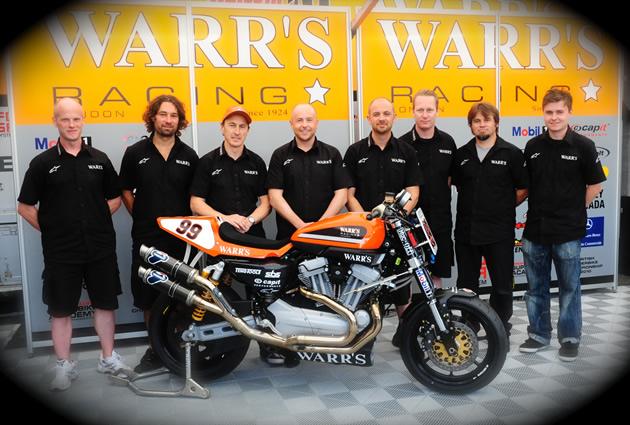Darren James standing with members of the Warr's Harley-Davidson racing team.