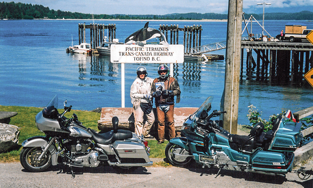 Gina and Les Tottle standing by their bikes in the bay at Tofino, B.C.