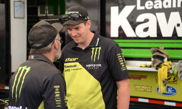 Mike Smith talking with another man in the pits.