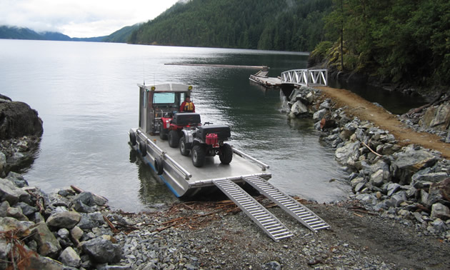 Offloading ATVs from a barge on Powell Lake.