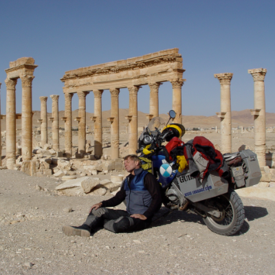 Glen Heggstad rests in the Roman ruins at Palmyra, Syria