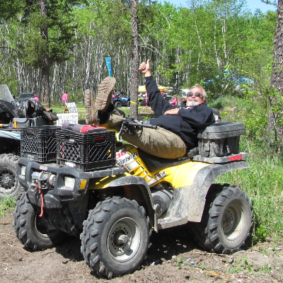 An ATVer gives a thumbs up while resting on his ATV.