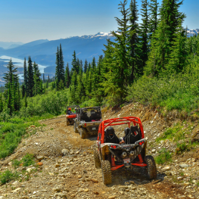 ATVs ascend a mountain road.