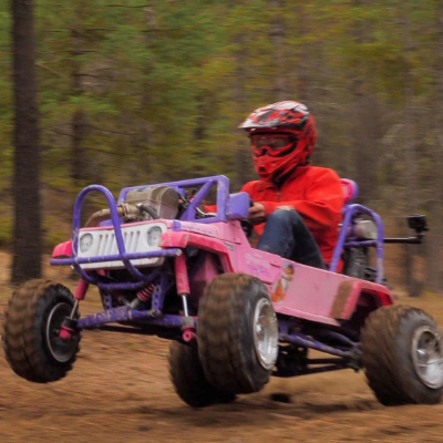 Ethan Schlussler rides a Power Wheels Barbie Jeep off-road go kart with a CRF 450 dirt bike engine.