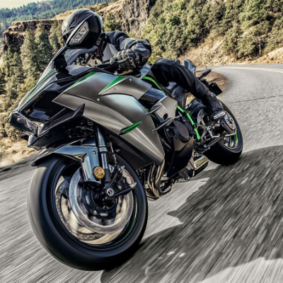A grey, green and black 2021 Kawasaki Ninja H2R motorcycle.