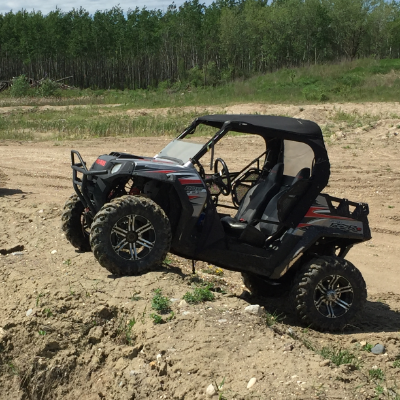 An ATV idles on rocky terrain.