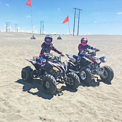 Kids ride ATVs