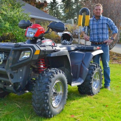 David Sullivan stands next to an ATV with a Quadbar