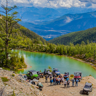 The Kootenay Rockies ATV Club poses in front of a small lake outside of Cranbrook