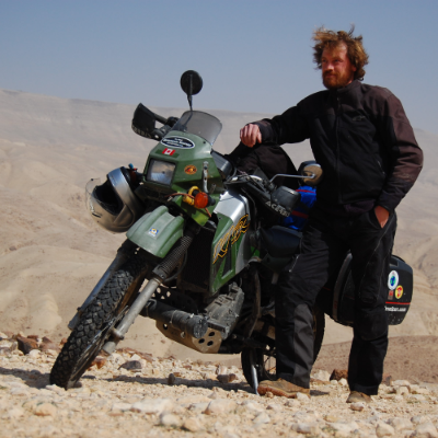 Jeremy Kroeker is an author and world traveller (here, near the Dead Sea).