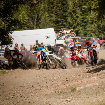 The Panorama Hare Scramble sees many riders competing for positioning in tight confines.