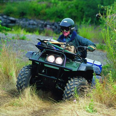An ATV rider wearing a helmet