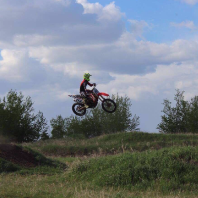 A motorcyclist gets air over a jump