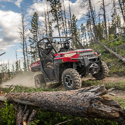 An ATV rides through the woods