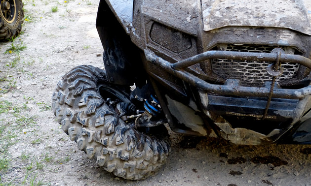 A SxS with a busted wheel.