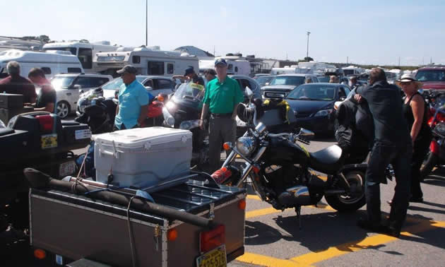 Motorcycles and cars on the ferry terminal.
