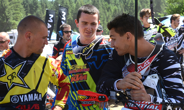 Bobby Kiniry, Cole Thompson and Colton Facciotti talking in the pits.