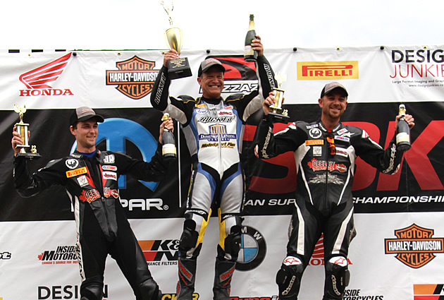 Darren James on the podium with Steve Crevier and John Ross McRae.