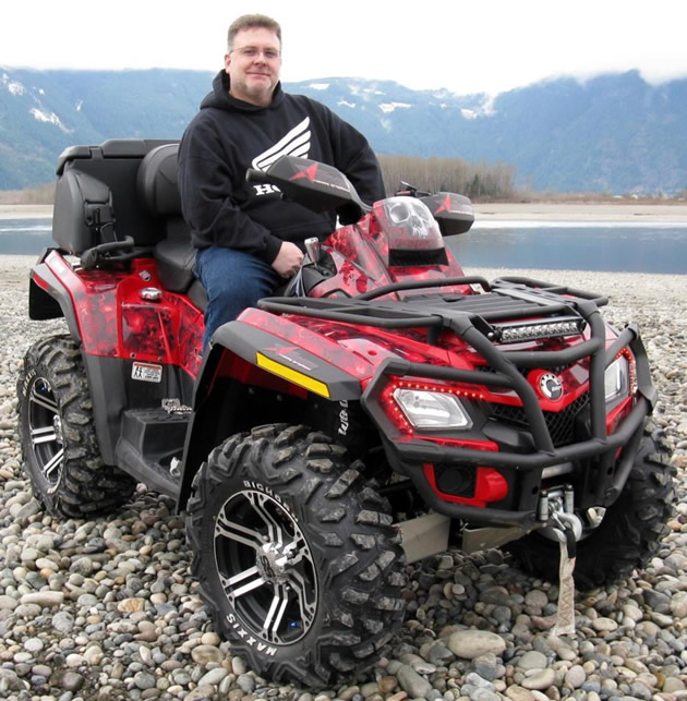 An ATVer sitting on a quad.