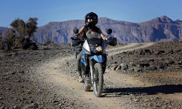 Rosie Gabrielle motorcycling in Africa.