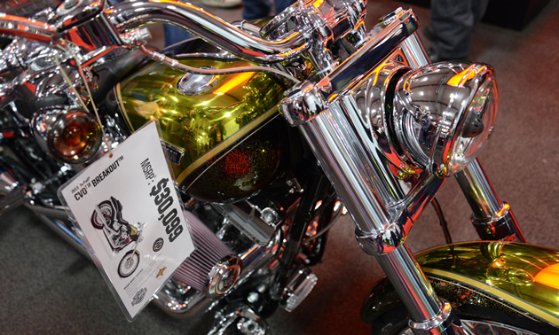 A close up of a shiny gold motorcycle.